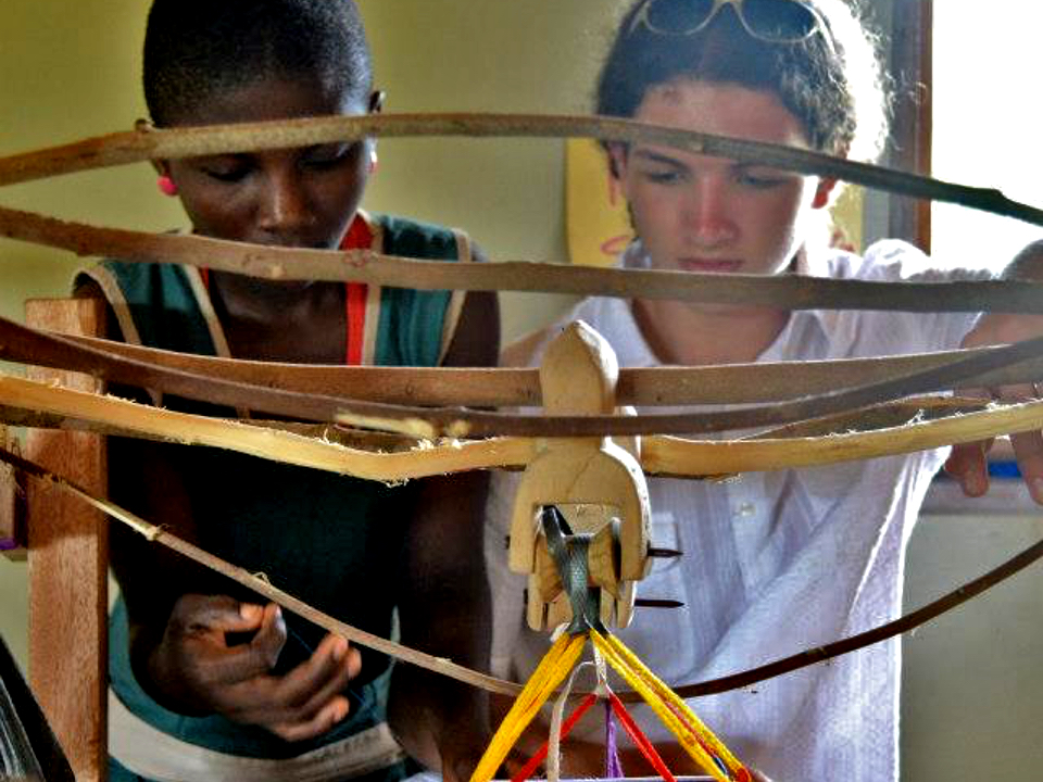 A Volunteer Learns the techniques of Making a Traditional Kente Cloth Weaving